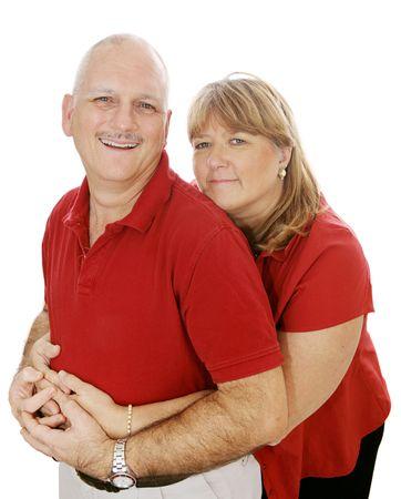 pareja madura feliz: Feliz pareja madura en el amor. Aislado en blanco.