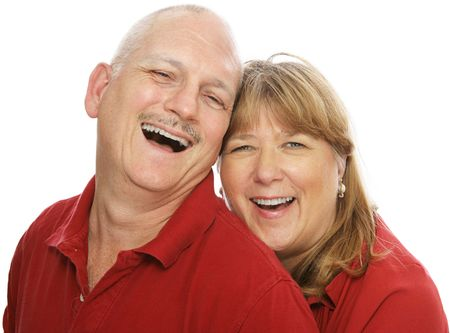 Happy middle aged couple laughing together.  Isolated on white. photo