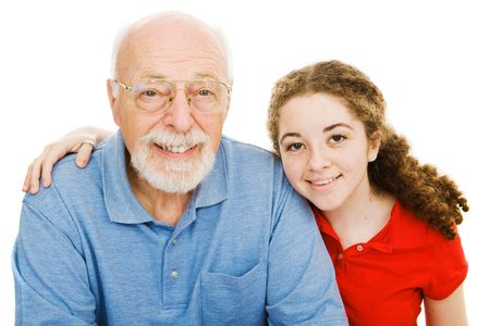 Pretty teen girl spending time with her handsome grandfather.  Isolated on white.
