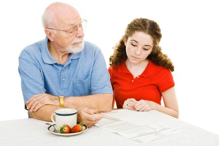 Grandfather explains the democratic process to his teen granddaughter.  Isolated on white.   Banco de Imagens