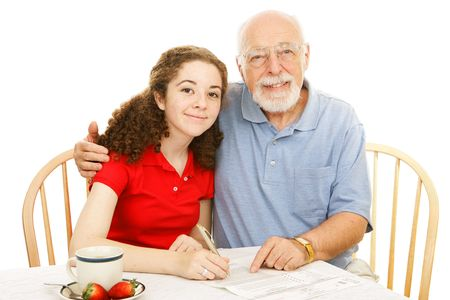 absentee: Grandfather helping his teen granddaughter fill out an absentee ballot.  Isolated on white. Stock Photo