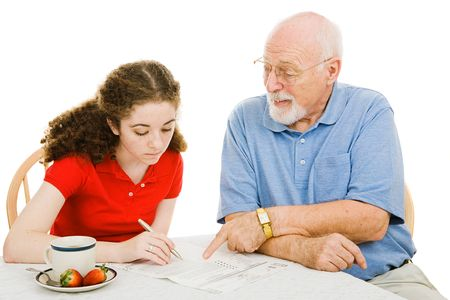 absentee: Grandfather helping teen girl fill out paperwork (absentee ballot).  Isolated on white.  Stock Photo