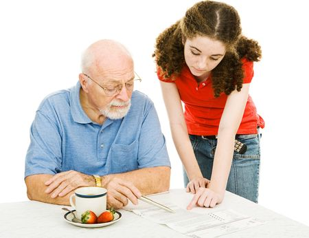 absentee: Teen girl helping her grandfather read the fine print on his absentee ballot.  Isolated on white.