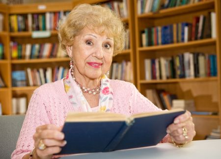 Beautiful senior woman studying in the library.   Stock Photo - 2834895