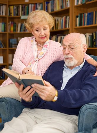Senior couple enjoys reading a good book together.   Stock Photo - 2834899
