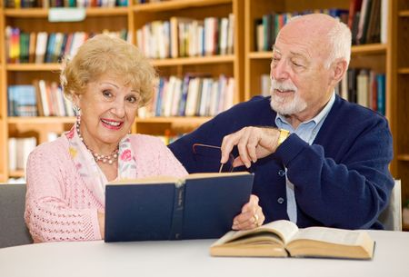 Senior lady happy because she met the man of her dreams in the library.  Focus on the woman.   Stock Photo - 2834893