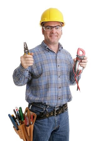 Electrician in safety goggles & hardhat holding up his wirestrippers and voltage meter.  Authentic and accurate content depiction - model is actual master electrician.