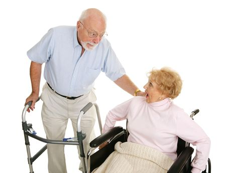 Senior man and woman in a nursing home exchanging gossip.  Isolated on white.   photo