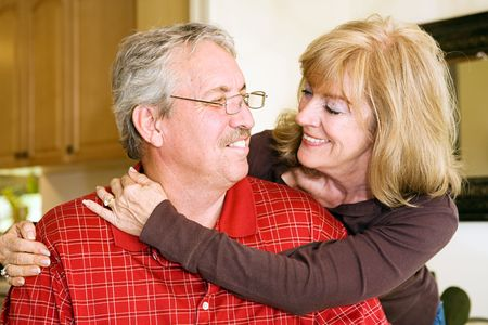 Beautiful mature couple in love.  Focus on his smiling face. Stock Photo - 2870385