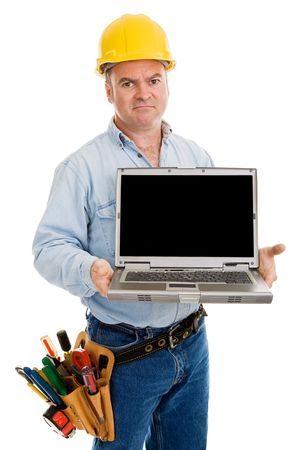 journeyman technician: Disgruntled construction worker holding a computer with blank space for a message.  Isolated on white.   Stock Photo