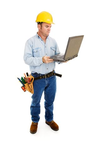 architect tools: Full body view of a construction contractor working on his laptop.  Full Body isolated on white.