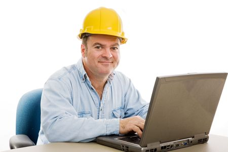 Friendly contractor in his office reviewing the plans on his computer.  Isolated on white. photo