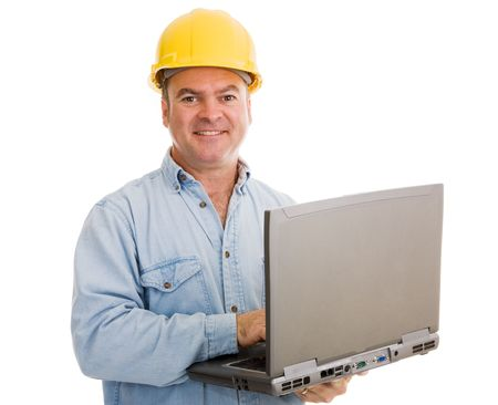 journeyman technician: Construction contractor using his laptop.  Isolated on white.