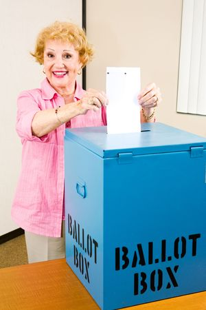 electronic voting: Senior woman casting her vote in the election.   Stock Photo