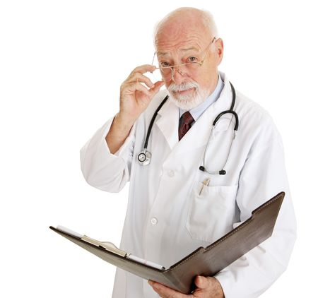 doctors tools: Serious mature doctor wants to discuss your medical history.  Isolated on white. Stock Photo