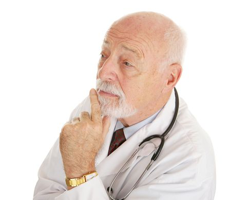 experienced: Mature, experienced doctor lost in thought.  Isolated on white.