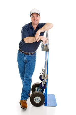 leaning on the truck: Friendly delivery man leaning against his hand truck.  Full body isolated on white.