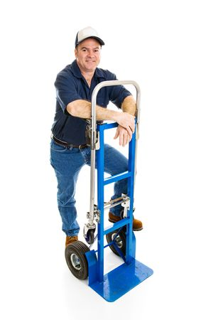 hand truck: Delivery man leaning against his hand truck.  Full body isolated on white.