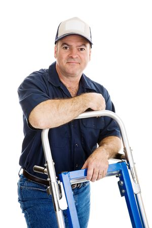 hand truck: Handsome delivery man leaning on his hand truck.  Isolated on white.