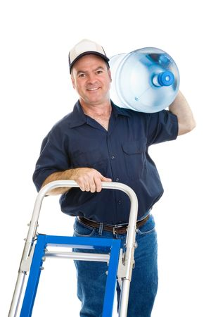 Cheerful water delivery man pushing his hand cart with a 5 gallon jug on his shoulder.  Isolated on white.   photo