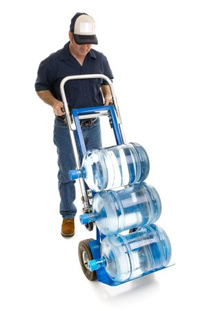 delivery room: Delivery man bringing five gallon water bottles on a hand truck.  Room for your logo on his hat.  Full body isolated on white.   Stock Photo