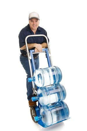Friendly delivery man bringing 5 gallon water jugs on a hand cart.  Full Body isolated on white. Stock Photo