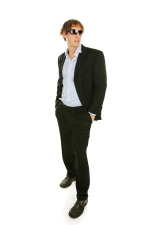 Handsome young businessman in sunglasses.  Full body isolated on white.   Stock Photo