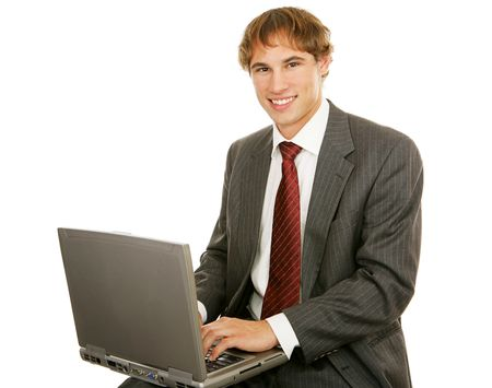 Handsome young businessman typing on his laptop.  Isolated on white. Stock Photo - 3008126