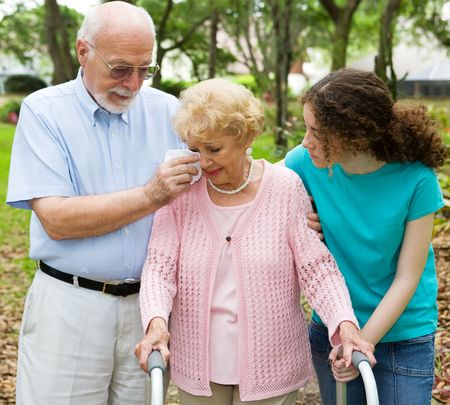 Senior woman with disability crying as her husband and granddaughter comfort her.   Stock Photo - 3051237