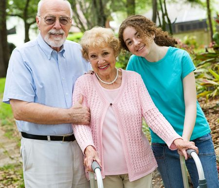 jewish: Happy grandparents enjoying time with their teen granddaughter. Stock Photo