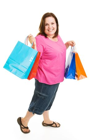 plus sized: Pretty plus sized woman excited about bargain shopping.  Full body isolatedo on white. Stock Photo