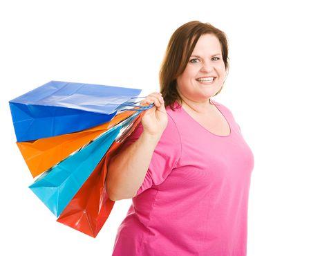 plus sized: Happy plus sized model holding shopping bags.  Isolated on white.