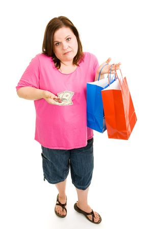 Woman holding shopping bags and looking disappointed at the small amount of change she has left over. Isolated on white. Stock Photo - 3072282