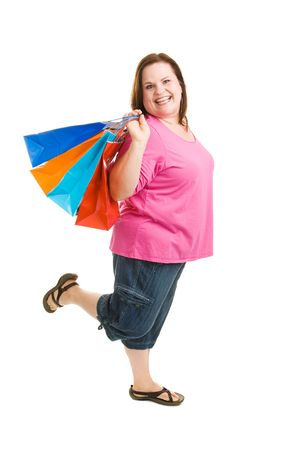 Happy enthusiastic plus sized woman on a shopping trip.  Full body isolated on white.