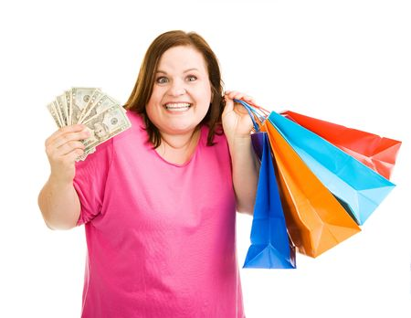 Beautiful plus-sized model holding cash in one hand and shopping bags in the other.  Isolated on white. photo