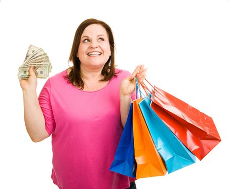 plus sized: Beautiful plus sized woman with a hand full of cash and shopping bags, wondering what to buy next.  Isolated on white.