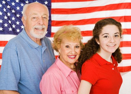 Grandparents and their granddaughter in front of an American Flag. Stock Photo - 3079859