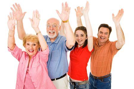 조부모, 아버지, 및 십 대 소녀 모두 그들의 손을 흥분 하 게 제기하는 가족. 흰색으로 격리. 스톡 콘텐츠