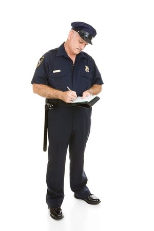 Full body view of police officer writing traffic citation. Isolated on white. (badge and patches are generic, not trademarked)