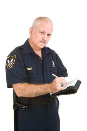 Mature police officer with serious expression writing up your traffic ticket.  Isolated on white. (badge and patches are generic, not trademarked) Stock Photo