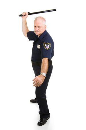 Police officer in aggressive posture, using his night stick.  Full body isolated on white.   (badge and patches are generic, not trademarked) photo