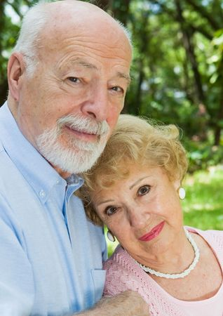 devoted: Portrait of a loving, devoted senior couple outdoors.