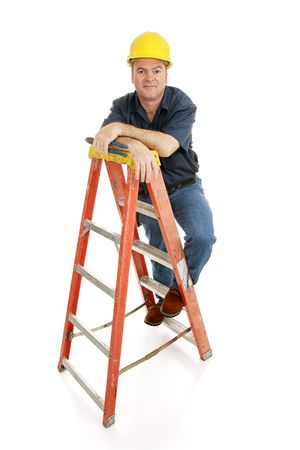 Friendly, typical construction worker on a ladder holding pliers.  Full body isolated on white.