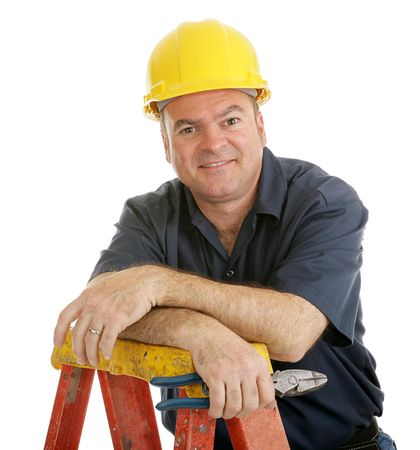 journeyman technician: Friendly, typical construction worker on top of a ladder holding a pliers.  Isolated on white.