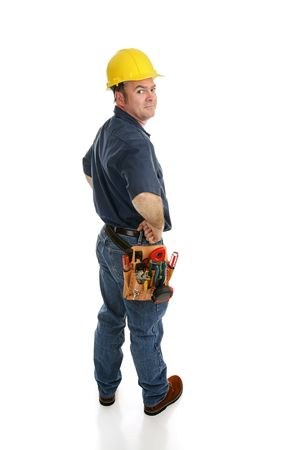 Side view of a construction worker looking over his shoulder.  Full body isolated on white.   Stock Photo - 3121603