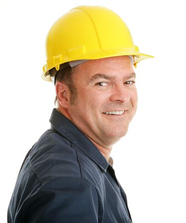 journeyman: Portrait of a typical construction worker smiling,  in a hardhat against a white background.   Stock Photo
