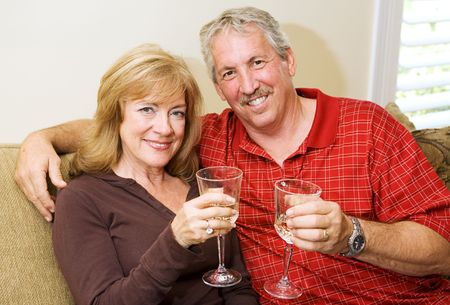 Beautiful mature couple enjoying a glass of wine together at home. Stock Photo - 3131920