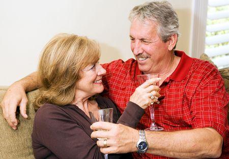 Beautiful mature couple relaxing together with a glass of wine. Stock Photo - 3131919