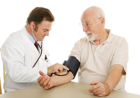 Senior man at the doctor having his blood pressure checked.  Isolated on white.   photo