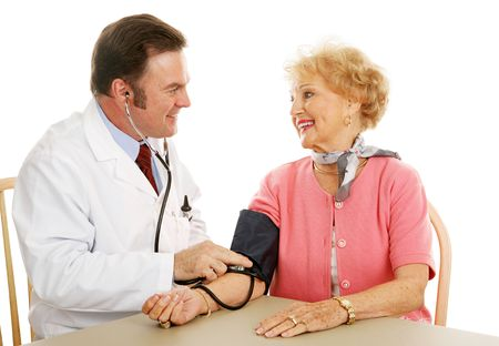 Senior woman with her doctor.  They are happy her blood pressure is normal. Stock Photo - 3190621